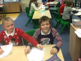 Working on our shape and Space work and Christmas Co-ordinates cards while wearing our Christmas Jumpers