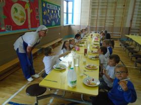 Nursery have their dinner in the big school canteen.
