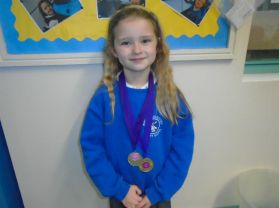 P3 girl wins 2 medals for her Gymnastics